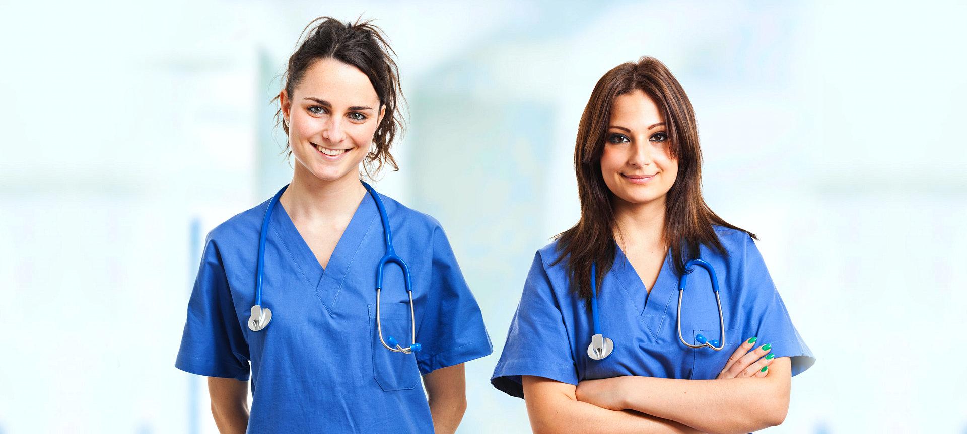 two female nurses smiling